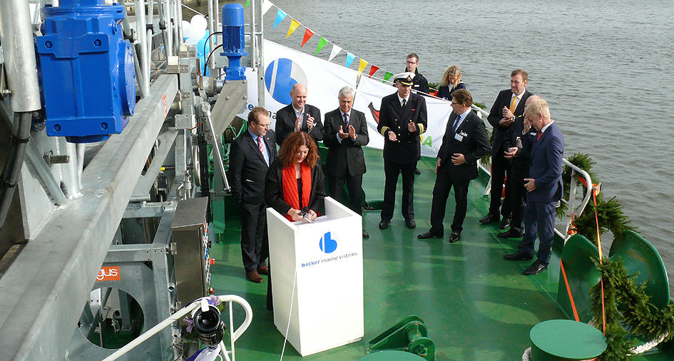 "2014: Celebrating the launch of the Hybrid Power Barge ""Hummel"" in the port of Hamburg."